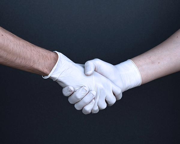 socially-distanced-real-estate-broadpoint-properties-handshake