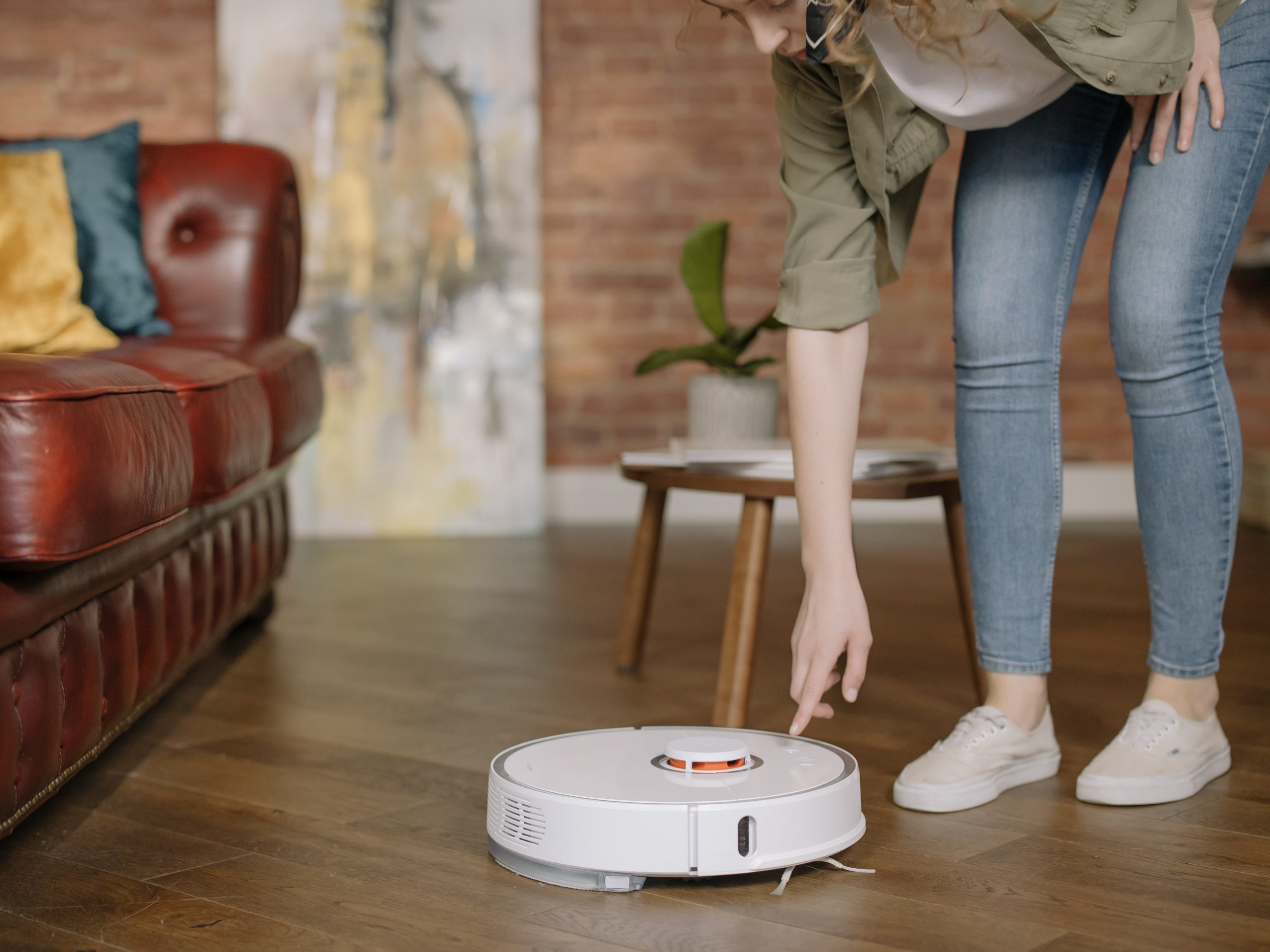 woman using a robot vacuum